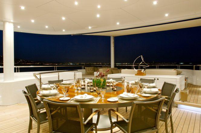 Superyacht SIREN - Alfresco dining on the main deck aft. Photo credit Nobiskrug
