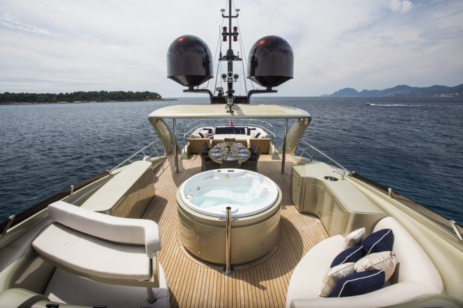 The Jacuzzi, sunpads and alfresco dining area aboard superyacht MIDNIGHT SUN