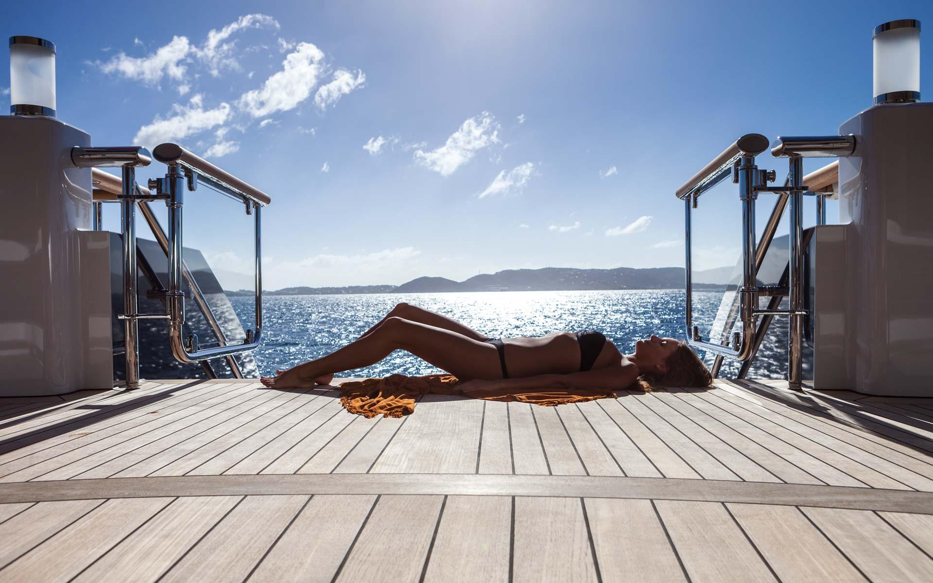 Aft deck sunbathing. Superyacht Solandge — Yacht Charter ...