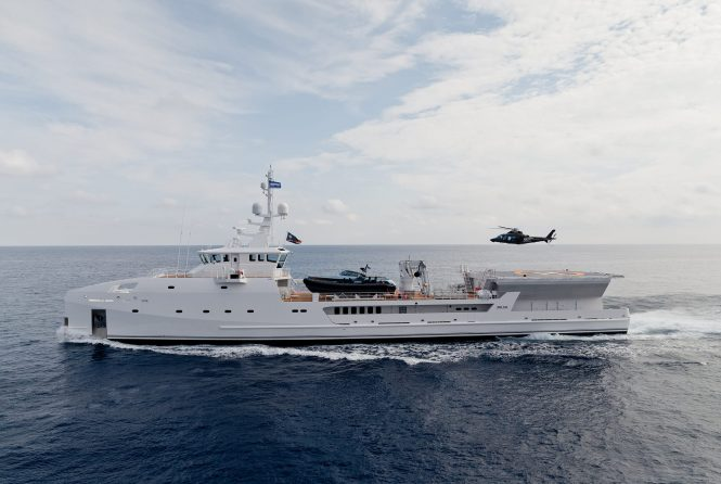 Luxury explorer superyacht support vessel GAME CHANGER by DAMEN with helicopter