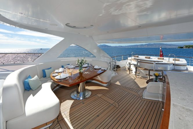 Sun deck with alfresco dining area and jacuzzi