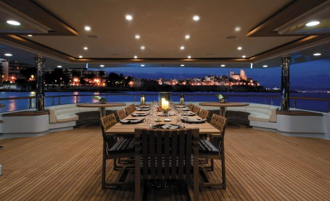 Beautiful aft deck alfresco dining set up in the evening