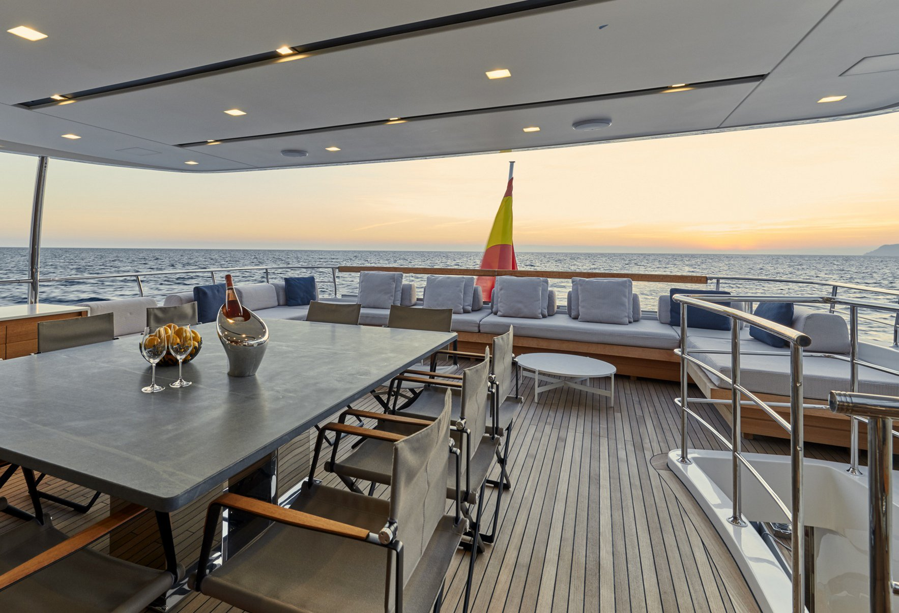 Aft deck alfresco dining area with seating