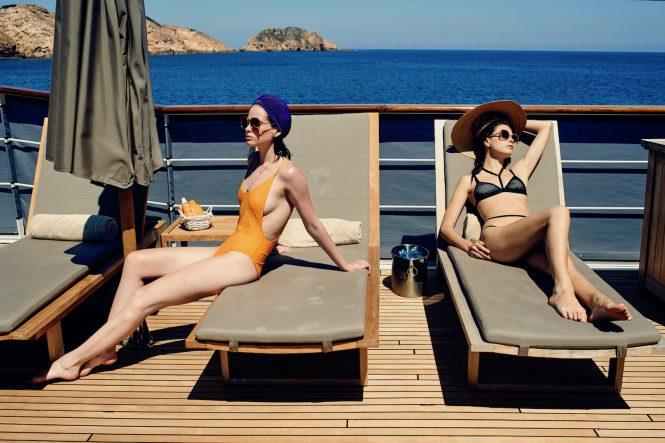 Sunbathing aboard Menorca classic yacht