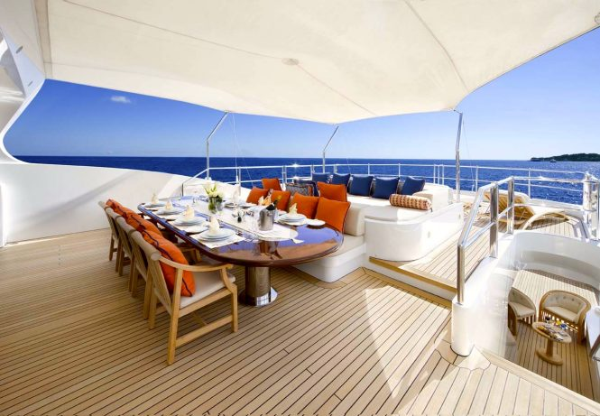 Alfresco dining and lounging areas on sun deck