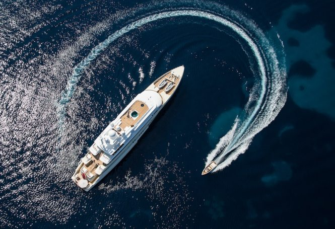 Aerial view of the yacht with a tender