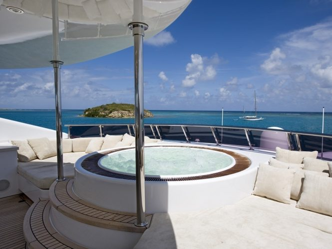 Jacuzzi on board surrounded by sun pads