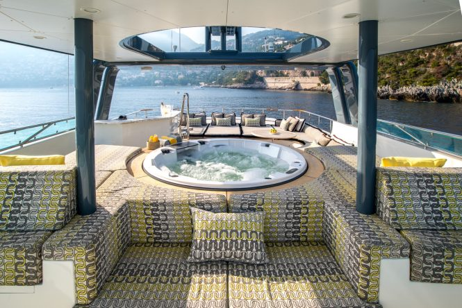 Sun deck with large Jacuzzi and sun pads