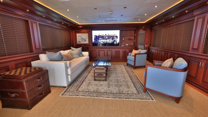Classically styled sky lounge with a large TV
