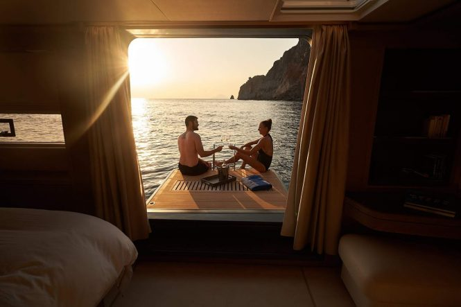 Fold-out swim platform or terrace from the master stateroom