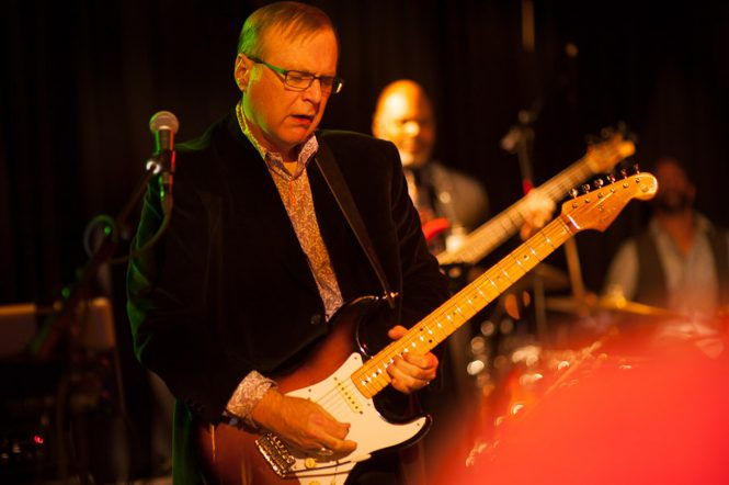 Paul Allen was an accomplished musician. Seen here playing the guitar