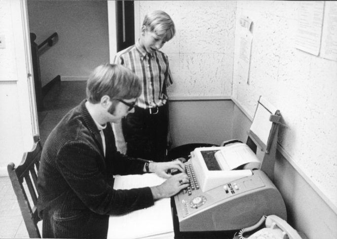Paul Allen with Bill Gates in front of a teletype machine at the Lakeside School in 1970. Courtesy Lakeside School