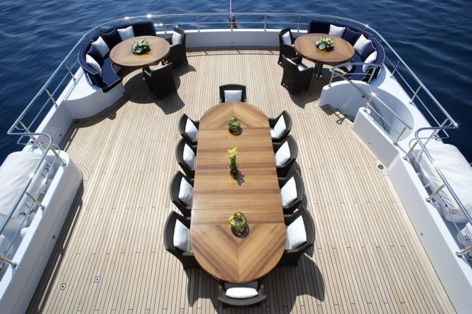 Top deck dining area with plenty of seating around the large table