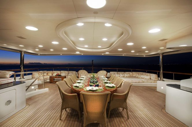 Aft deck alfresco dining area in the evening