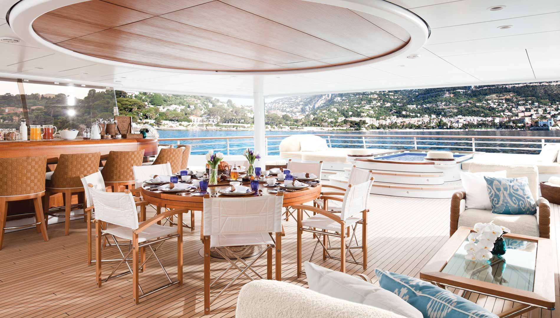 Sun deck with Jacuzzi, bar and seating