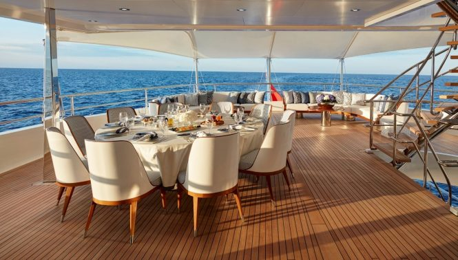 Aft deck alfresco dining area with seating area