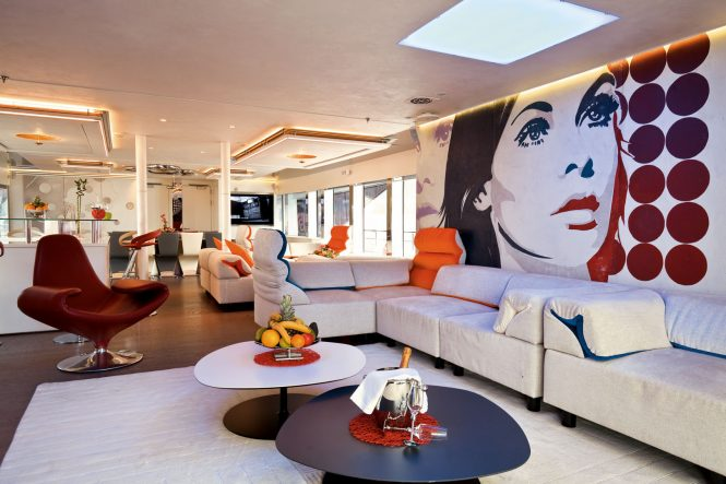 Spacious modern saloon with contemporary art and design