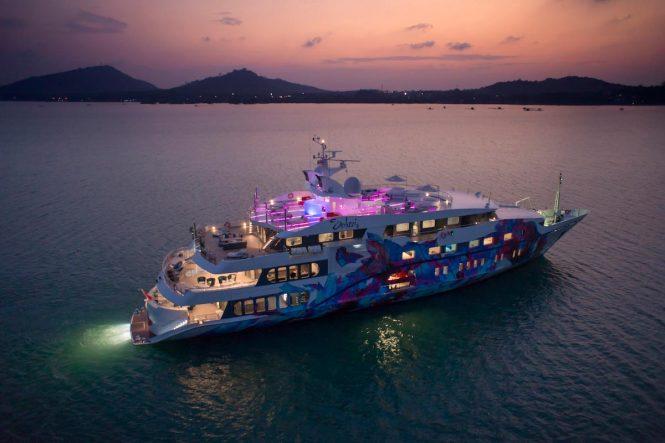 Charter yacht SALUZI at night