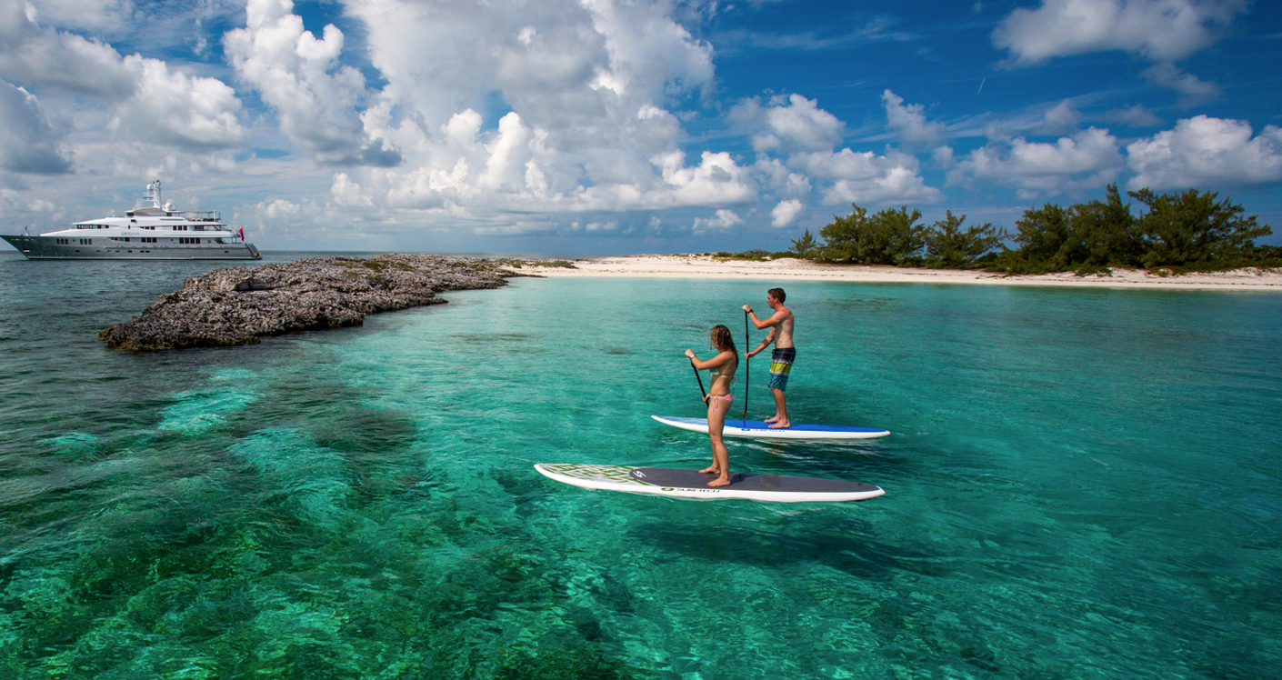 Paddle boarding in South Pacific on a superyacht charter