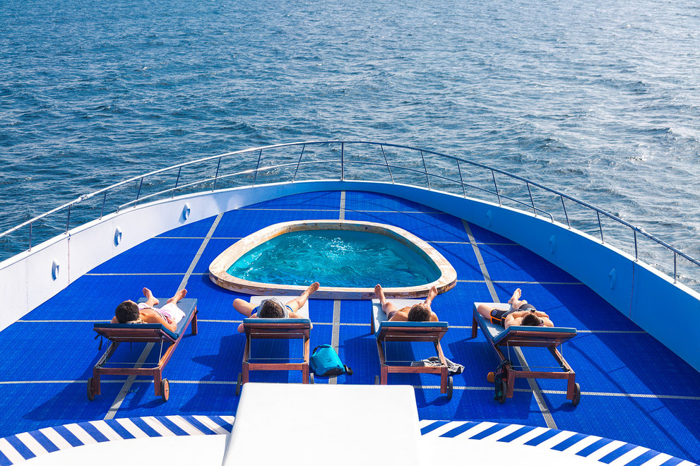 Yacht pool on deck with sun loungers
