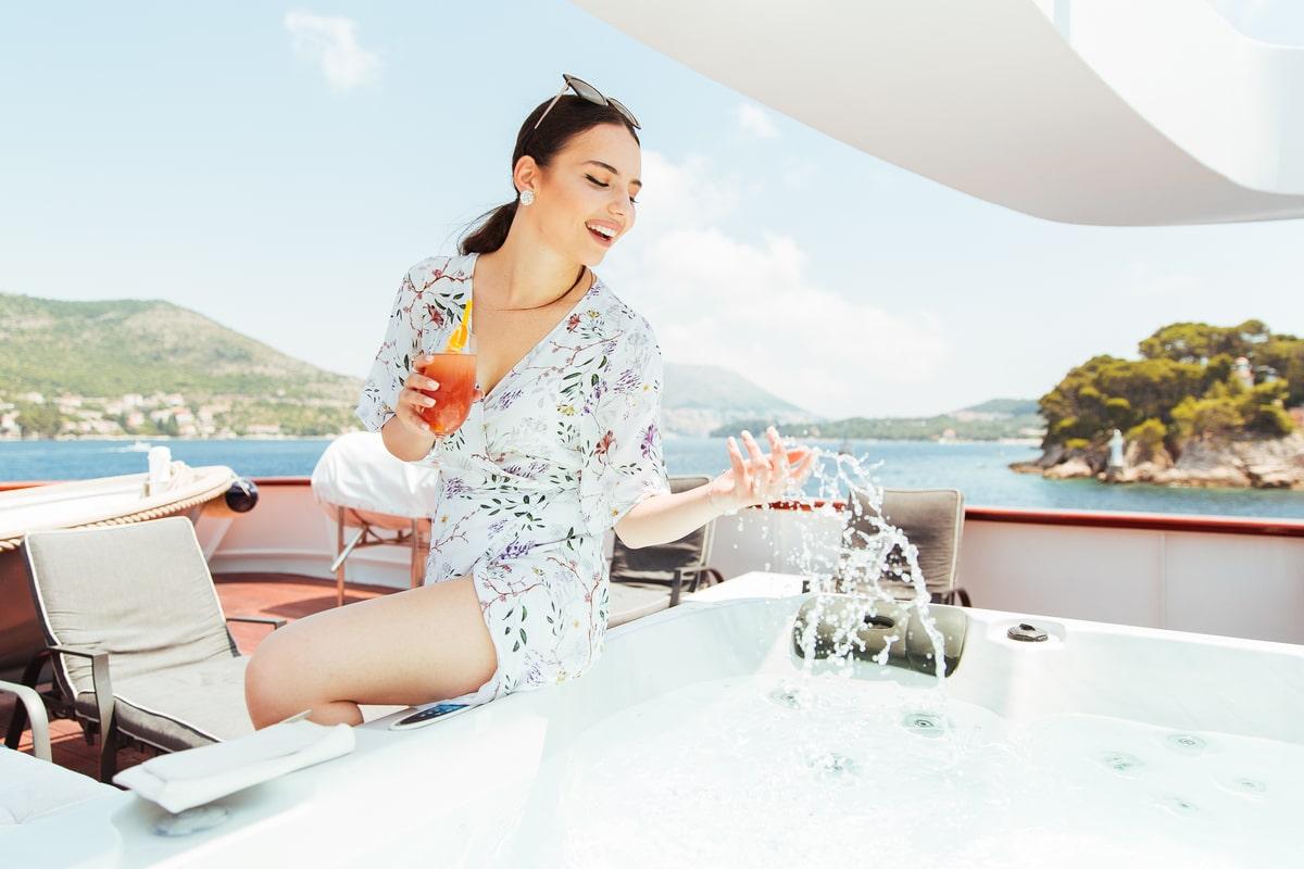 Enjoying the Jacuzzi on a yacht