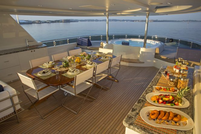 Sun deck with a Jacuzzi and an alfresco dining area © Billy Black Photography