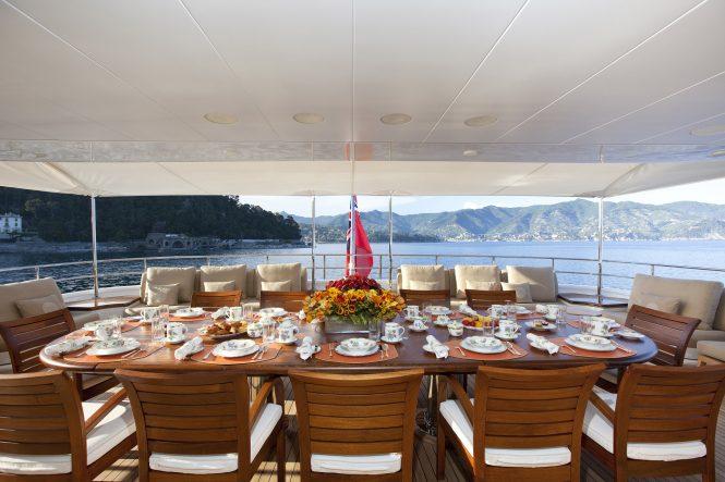 alfresco dining set up on aft deck