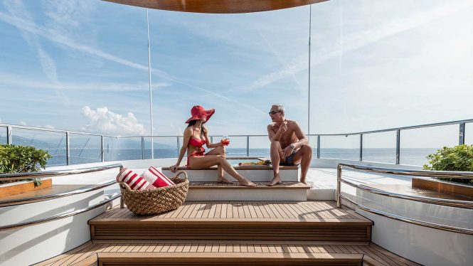 Enjoying the Jacuzzi and the sunshine on superyacht charter