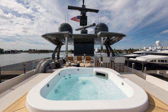 Jacuzzi on deck with sunbathing area
