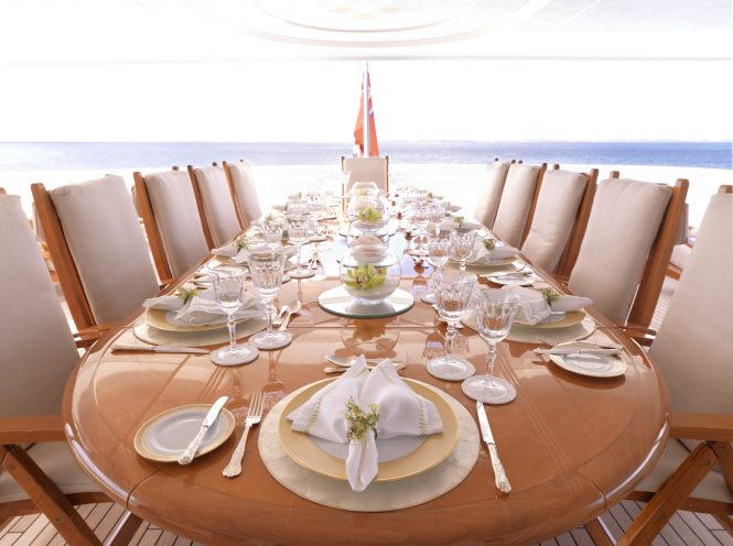 Luxurious dining set up aboard APOGEE available in the Caribbean and Mediterranean