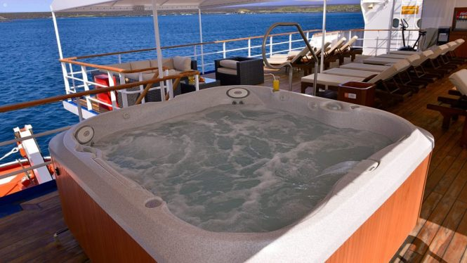 Plenty of sunbathing areas with on deck Jacuzzi