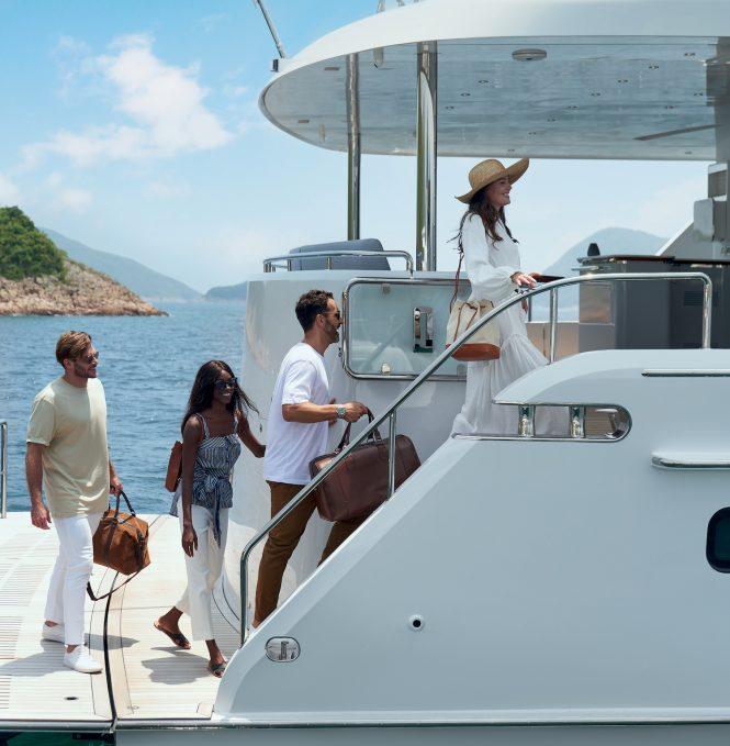 arriving aboard motor yacht CLB 88