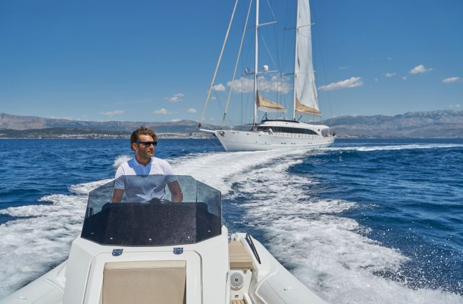 Sailing yacht ACAPELLA with her tender